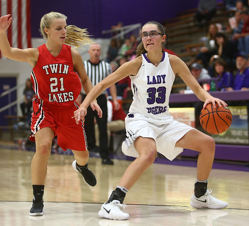 11-4-17<br /> Northwestern vs Twin Lakes girls basketball<br /> Madison Layden dribbles to the basket.<br /> Kelly Lafferty Gerber | Kokomo Tribune