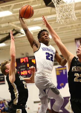 11-21-17<br /> Northwestern vs Madison Grant boys basketball<br /> Tayson Parker heads to the basket.<br /> Kelly Lafferty Gerber | Kokomo Tribune
