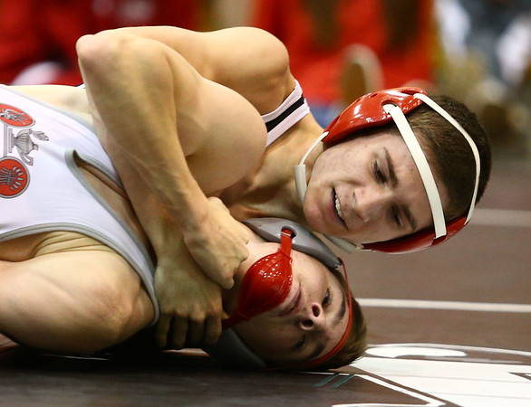 11-18-17 <br /> Western wrestling<br /> Western's Tyler Lechner in the 126 takes down his Fisher's opponent.<br /> Kelly Lafferty Gerber | Kokomo Tribune