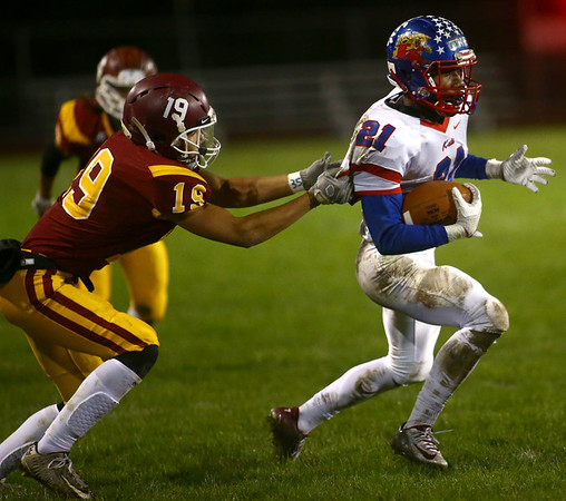 11-3-17<br /> Kokomo vs McCutcheon sectional championship<br /> Steven Edwards runs the ball.<br /> Kelly Lafferty Gerber | Kokomo Tribune