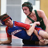 11-29-17<br /> Eastern vs Kokomo wrestling<br /> Eastern's Cory Hendricks takes down Kokomo's Wilmer Corrales in the 113.<br /> Kelly Lafferty Gerber | Kokomo Tribune
