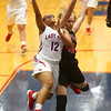 11-8-17<br /> Kokomo vs Taylor girls basketball<br /> Tevin Deckard goes up for a shot is fouled by Mady Delgado at the basket.<br /> Kelly Lafferty Gerber | Kokomo Tribune