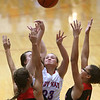 11-8-17<br /> Kokomo vs Taylor girls basketball<br /> Kokomo's Olivia Branch tries to put up a shot amid Taylor's defense.<br /> Kelly Lafferty Gerber | Kokomo Tribune