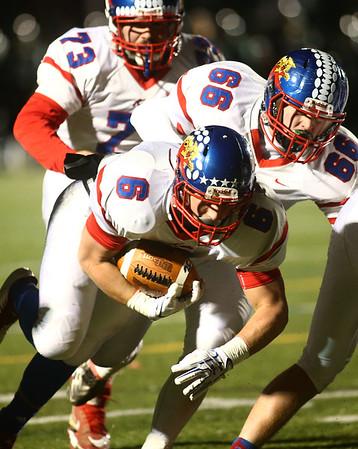 11-10-17<br /> Kokomo vs Zionsville regional<br /> Jack Perkins tumbles into the endzone for a touchdown.<br /> Kelly Lafferty Gerber | Kokomo Tribune