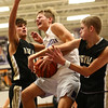 11-21-17<br /> Northwestern vs Madison Grant boys basketball<br /> Logan Bowser gets fouled on the way to the basket.<br /> Kelly Lafferty Gerber | Kokomo Tribune