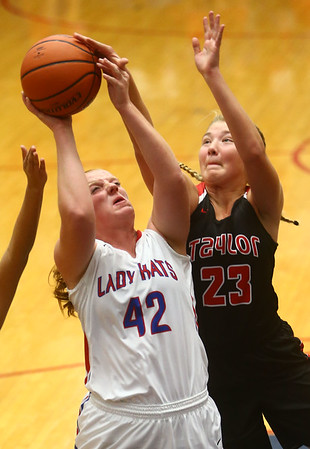 11-8-17<br /> Kokomo vs Taylor girls basketball<br /> Madison Wood goes up for a shot as Taylor's Ashlen Kropczynski attempts to block.<br /> Kelly Lafferty Gerber | Kokomo Tribune