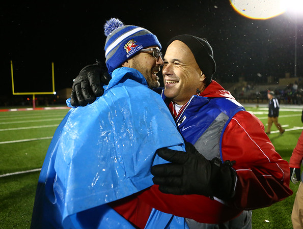 Coach Colby, right, celebrates with other football coaches after the semistate win last Friday.<br /> Kelly Lafferty Gerber | Kokomo Tribune