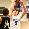 11-21-17<br /> Northwestern vs Madison Grant boys basketball<br /> Ben Harris shoots.<br /> Kelly Lafferty Gerber | Kokomo Tribune