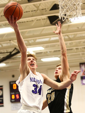 11-21-17<br /> Northwestern vs Madison Grant boys basketball<br /> Brayden Maple shoots.<br /> Kelly Lafferty Gerber | Kokomo Tribune