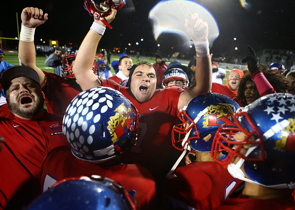 11-17-17<br /> Kokomo semi state football<br /> The Kats celebrate with coaches and fans after their semistate win.<br /> Kelly Lafferty Gerber | Kokomo Tribune
