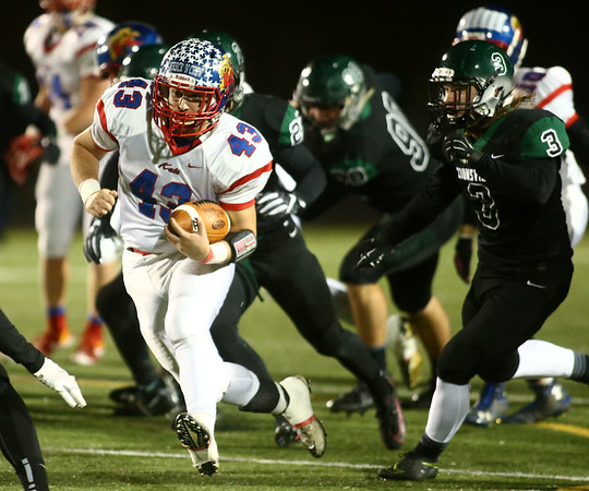 11-10-17<br /> Kokomo vs Zionsville regional<br /> Noah Hurlock runs the ball.<br /> Kelly Lafferty Gerber | Kokomo Tribune