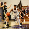 11-21-17<br /> Northwestern vs Madison Grant boys basketball<br /> Tayson Parker dribbles past MG down the court.<br /> Kelly Lafferty Gerber | Kokomo Tribune
