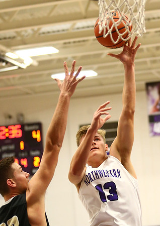 11-21-17<br /> Northwestern vs Madison Grant boys basketball<br /> T.J. Macaluso shoots.<br /> Kelly Lafferty Gerber | Kokomo Tribune