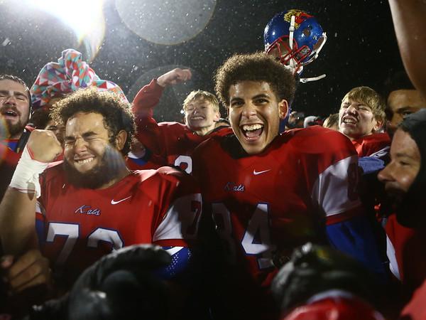 11-17-17<br /> Kokomo semi state football<br /> Kokomo's Aeden Ligon and Darius Thompson celebrate after Kats make history with their first ever semi-state win.<br /> Kelly Lafferty Gerber | Kokomo Tribune
