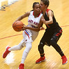11-8-17<br /> Kokomo vs Taylor girls basketball<br /> Tionna Brown and Taylor's Alison Pemberton go head to head as Brown dribbles to the basket.<br /> Kelly Lafferty Gerber | Kokomo Tribune