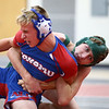 11-29-17<br /> Eastern vs Kokomo wrestling<br /> Eastern's Luke Hetzner takes down Kokomo's Taylor Duncan in the 126.<br /> Kelly Lafferty Gerber | Kokomo Tribune