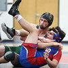 11-29-17<br /> Eastern vs Kokomo wrestling<br /> Eastern's Garrett Hetzner takes down Kokomo's David Harris in the 170.<br /> Kelly Lafferty Gerber | Kokomo Tribune