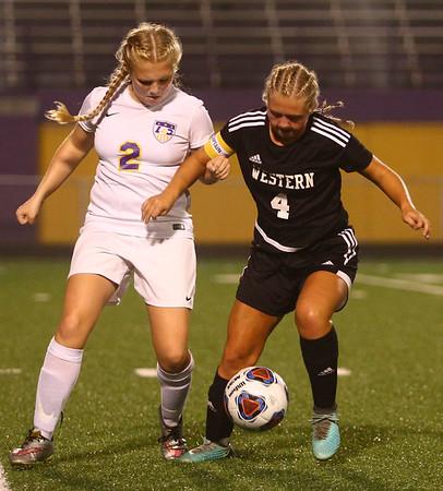 10-5-17<br /> Western vs Oak Hill girls soccer<br /> Marion's Claire Hendricks and Western's Faith Lytle go after the ball.<br /> Kelly Lafferty Gerber   Kokomo Tribune