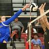 10-21-17<br /> Carroll vs Rochester volleyball<br /> Megan Herr hits it over the net.<br /> Kelly Lafferty Gerber | Kokomo Tribune