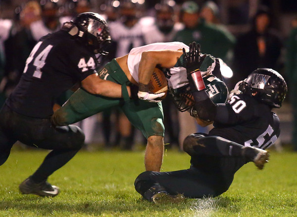 10-27-17<br /> Western vs Pendleton Heights football<br /> Western's Rick Bearden and Alex Newman bring down a PH player.<br /> Kelly Lafferty Gerber | Kokomo Tribune