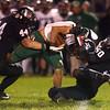 10-27-17<br /> Western vs Pendleton Heights football<br /> Western's Rick Bearden and Alex Newman bring down a PH player.<br /> Kelly Lafferty Gerber | Kokomo Tribune