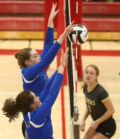10-21-17<br /> Carroll vs Rochester volleyball<br /> Carroll's Mia Moore and Morgan Viney block a hit.<br /> Kelly Lafferty Gerber | Kokomo Tribune