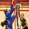 10-21-17<br /> Carroll vs Rochester volleyball<br /> Carroll's Mia Moore and Morgan Viney block a hit.<br /> Kelly Lafferty Gerber | Kokomo Tribune