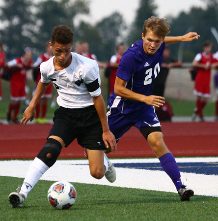 10-4-17<br /> Western vs Northwestern boys soccer<br /> Western's Elijah Woodring and NW's Jalen Diskey go after the ball.<br /> Kelly Lafferty Gerber | Kokomo Tribune