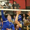 10-21-17<br /> Carroll vs Rochester volleyball<br /> Carroll's Megan Herr hits it over the net.<br /> Kelly Lafferty Gerber | Kokomo Tribune