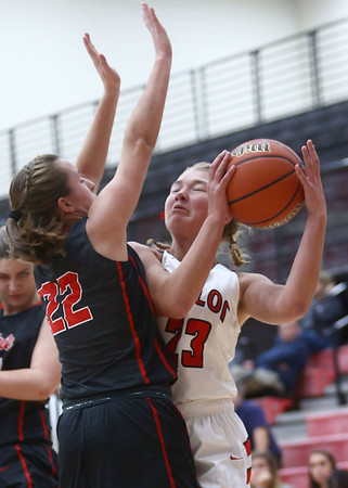 10-31-17<br /> Taylor vs Clinton Prairie girls basketball<br /> Taylor's Ashlen Kropczynski tries for a shot around CP's defense.<br /> Kelly Lafferty Gerber | Kokomo Tribune