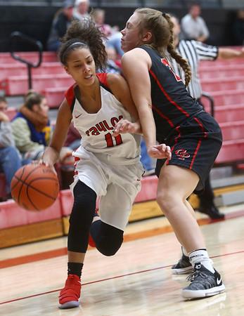 10-31-17<br /> Taylor vs Clinton Prairie girls basketball<br /> Asia Stabler looks to get around CP's defense.<br /> Kelly Lafferty Gerber | Kokomo Tribune