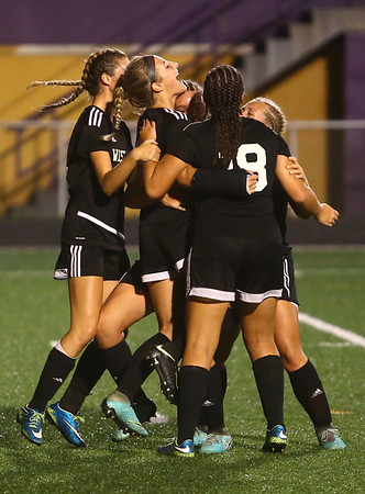 10-5-17<br /> Western vs Oak Hill girls soccer<br /> Sophia Weigt, center, celebrates with the team after she scores in the first half.<br /> Kelly Lafferty Gerber | Kokomo Tribune