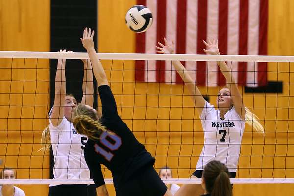 Volleyball sectional between Western HS and Maconaquah HS on October 12, 2017. Western's Clara Braswell and Hannah Merica going up to block a hit ftom Maconaquah's Emily Bowyer.<br /> Tim Bath | Kokomo Tribune