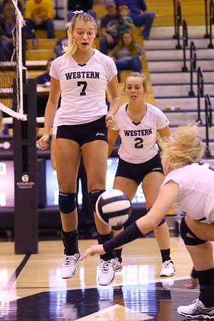 Volleyball sectional between Western HS and Maconaquah HS on October 12, 2017. Western's Hannah Merica gets excited as Hilary Merica scoops for a ball.<br /> Tim Bath   Kokomo Tribune