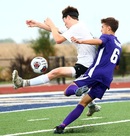 10-4-17<br /> Western vs Northwestern boys soccer<br /> Western's Max Harbaugh tries to prevent NW's Cameron Austin from getting to the ball.<br /> Kelly Lafferty Gerber | Kokomo Tribune