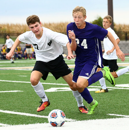 10-4-17<br /> Western vs Northwestern boys soccer<br /> Western's Collin Rassel and NW's Jackson Hale go after the ball.<br /> Kelly Lafferty Gerber | Kokomo Tribune