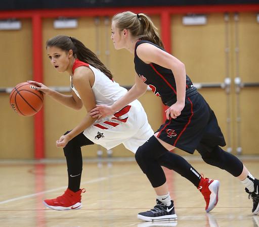 10-31-17<br /> Taylor vs Clinton Prairie girls basketball<br /> Alison Pemberton dribbles around CP's defense.<br /> Kelly Lafferty Gerber   Kokomo Tribune
