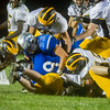 Cougars wide receiver Quinton Veach (9) runs into a swarm of Panther defenders in the third quarter as Pioneer cruised to a 55-21 victory over Carroll on Friday night. Fran Ruchalski   Pharos-Tribune