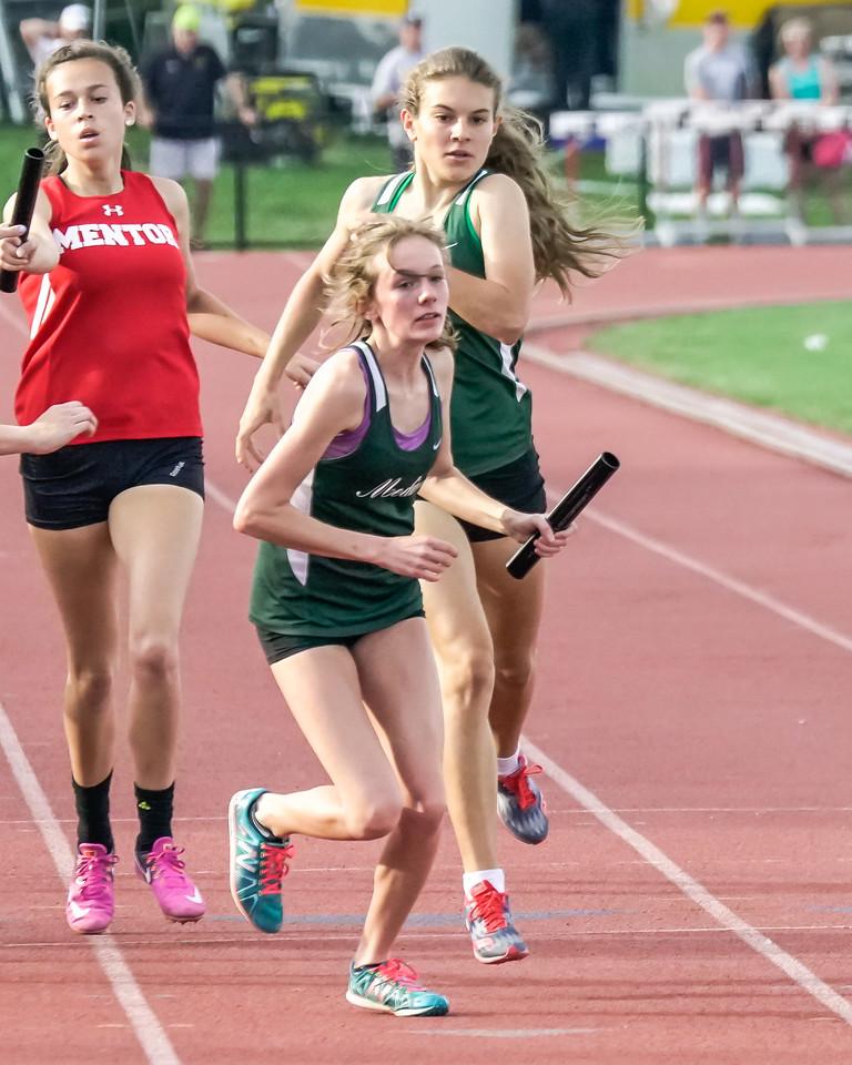 Medina'S Ava Tenaglia hands off to Juliette Keller in the 4x400 race at the state track meet Saturday. JOE COLON / GAZETTE