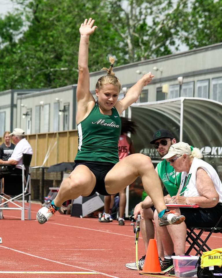 Medina's Riley Braun takes off in the long jump at the Ohio State meet Saturday. JOE COLON / GAZETTE