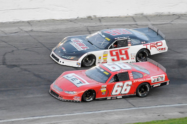 Don Knight   The Herald Bulletin<br /> Steve Wallace (66) passes Raphael Lassard (99) to take the lead in the Redbud 400 at Anderson Speesway on Saturday.