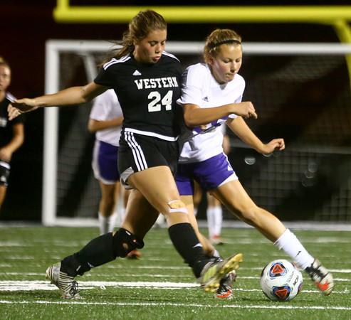 9-14-17<br /> Northwestern vs Western girls soccer<br /> Western's Taylor Kuhns blocks NW's Ashlyn Johnson's kick.<br /> Kelly Lafferty Gerber   Kokomo Tribune