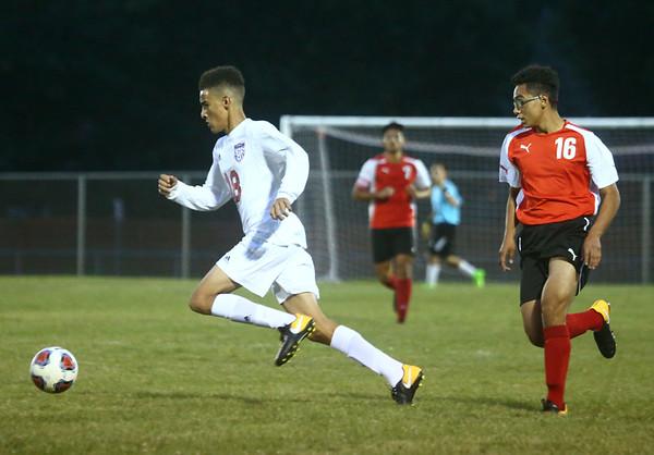 9-12-17<br /> Kokomo vs Logansport boys soccer<br /> Kokomo's Quincy Armstrong sprints after the ball.<br /> Kelly Lafferty Gerber | Kokomo Tribune