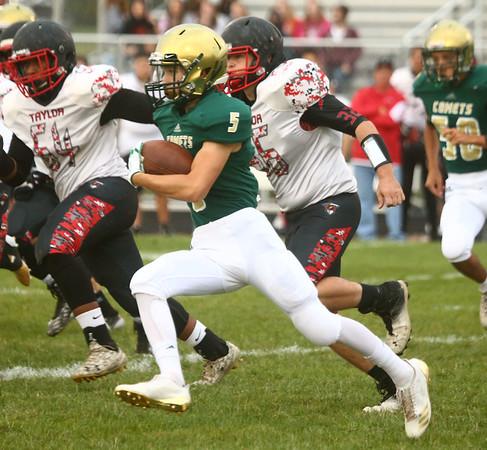 9-8-17<br /> Eastern vs Taylor football<br /> Eastern's Logan McNeil runs the ball.<br /> Kelly Lafferty Gerber | Kokomo Tribune