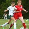 9-6-17<br /> Eastern vs Maconaquah girls soccer<br /> Eastern's Ellie Moore and Mac's Savanna Miracle battle over the control of the ball.<br /> Kelly Lafferty Gerber   Kokomo Tribune