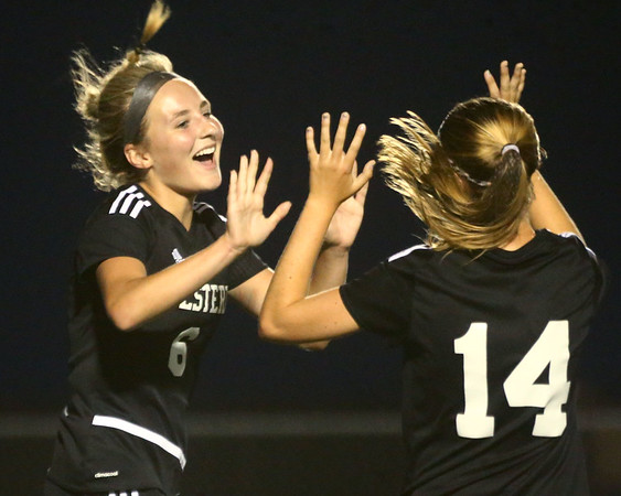9-14-17<br /> Northwestern vs Western girls soccer<br /> Western's Sophie Weigt is congratulated by teammate Alex Parr after Weigt scores.<br /> Kelly Lafferty Gerber | Kokomo Tribune