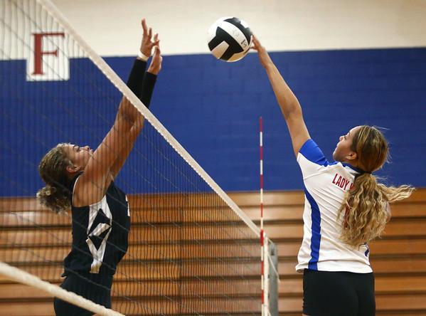 9-13-17<br /> Kokomo vs North Miami volleyball<br /> #11 tips the ball over the net.<br /> Kelly Lafferty Gerber | Kokomo Tribune