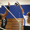 9-13-17<br /> Kokomo vs North Miami volleyball<br /> #11 tips the ball over the net.<br /> Kelly Lafferty Gerber | Kokomo Tribune