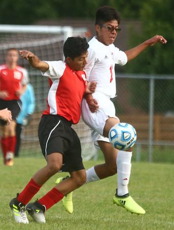 9-12-17<br /> Kokomo vs Logansport boys soccer<br /> Logan's Marco Macias and Kokomo's Eduardo Vazquez go after the ball.<br /> Kelly Lafferty Gerber | Kokomo Tribune