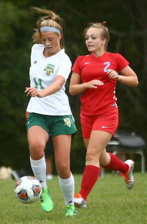9-6-17<br /> Eastern vs Maconaquah girls soccer<br /> Eastern's Mallorie Williams keeps the ball away from Mac's Sydne Leary.<br /> Kelly Lafferty Gerber | Kokomo Tribune